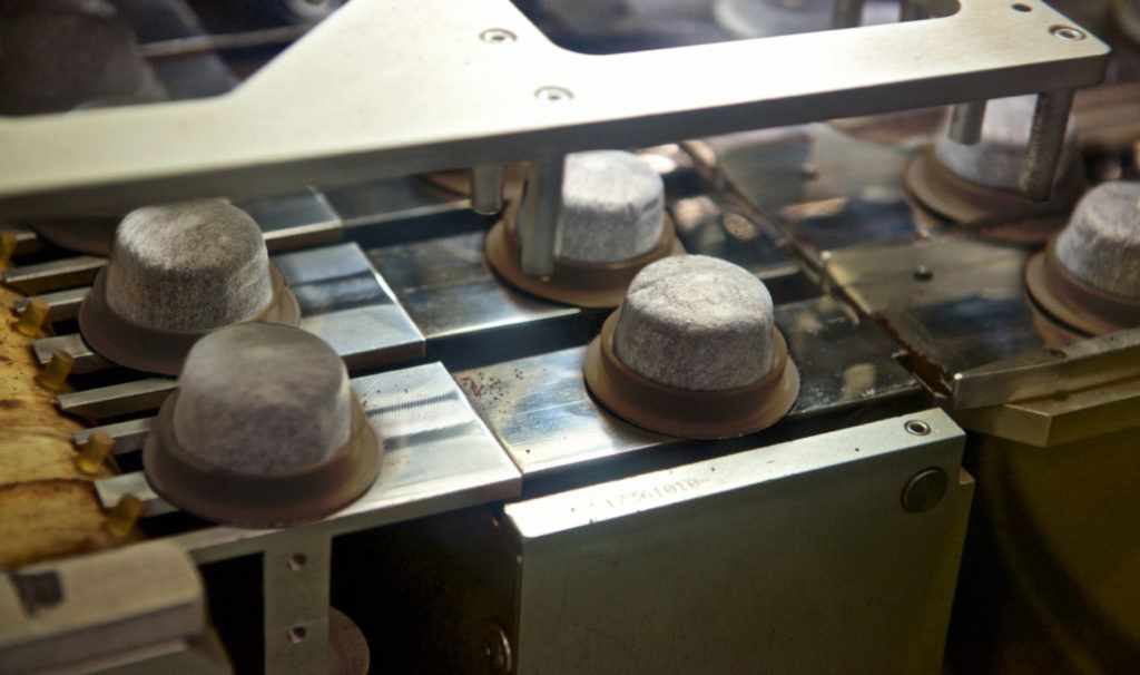 Compostable single-serve coffee pods being made in the factory.