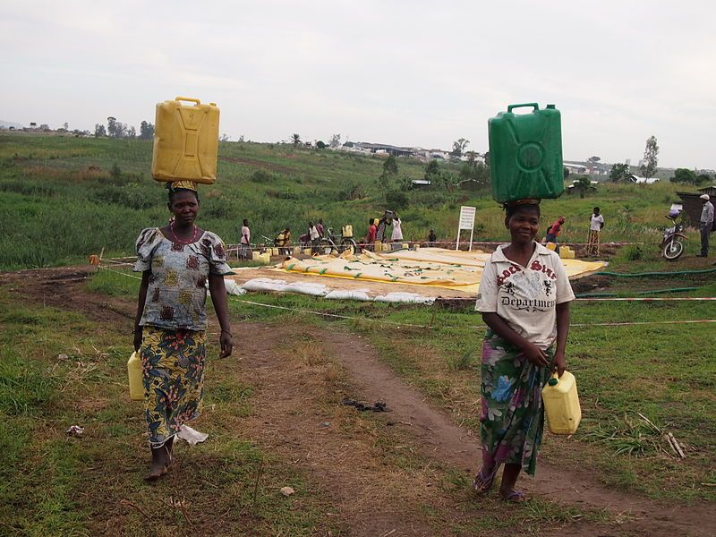 Women collect water in the DRC, where much of the water is unsafe to drink.