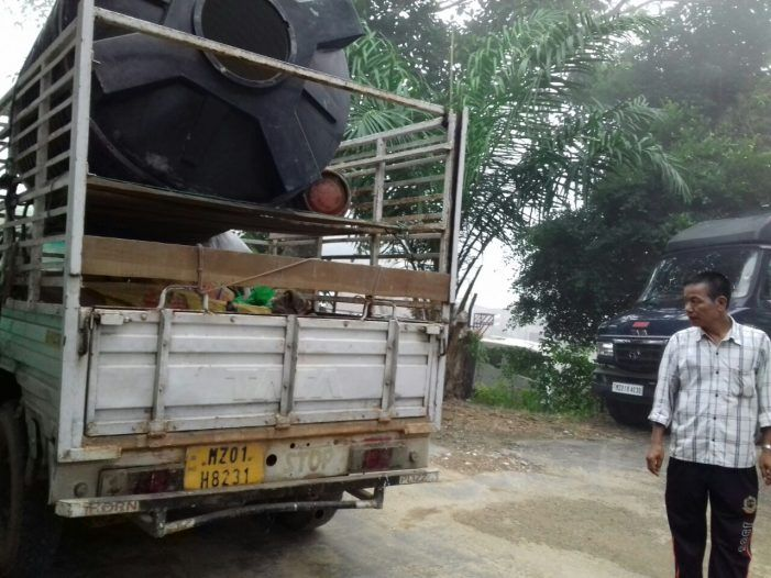 David Ialhruaitluanga, of India, stands by a truck. He helped rescue a shipment of dogs headed to be slaughtered for meat.