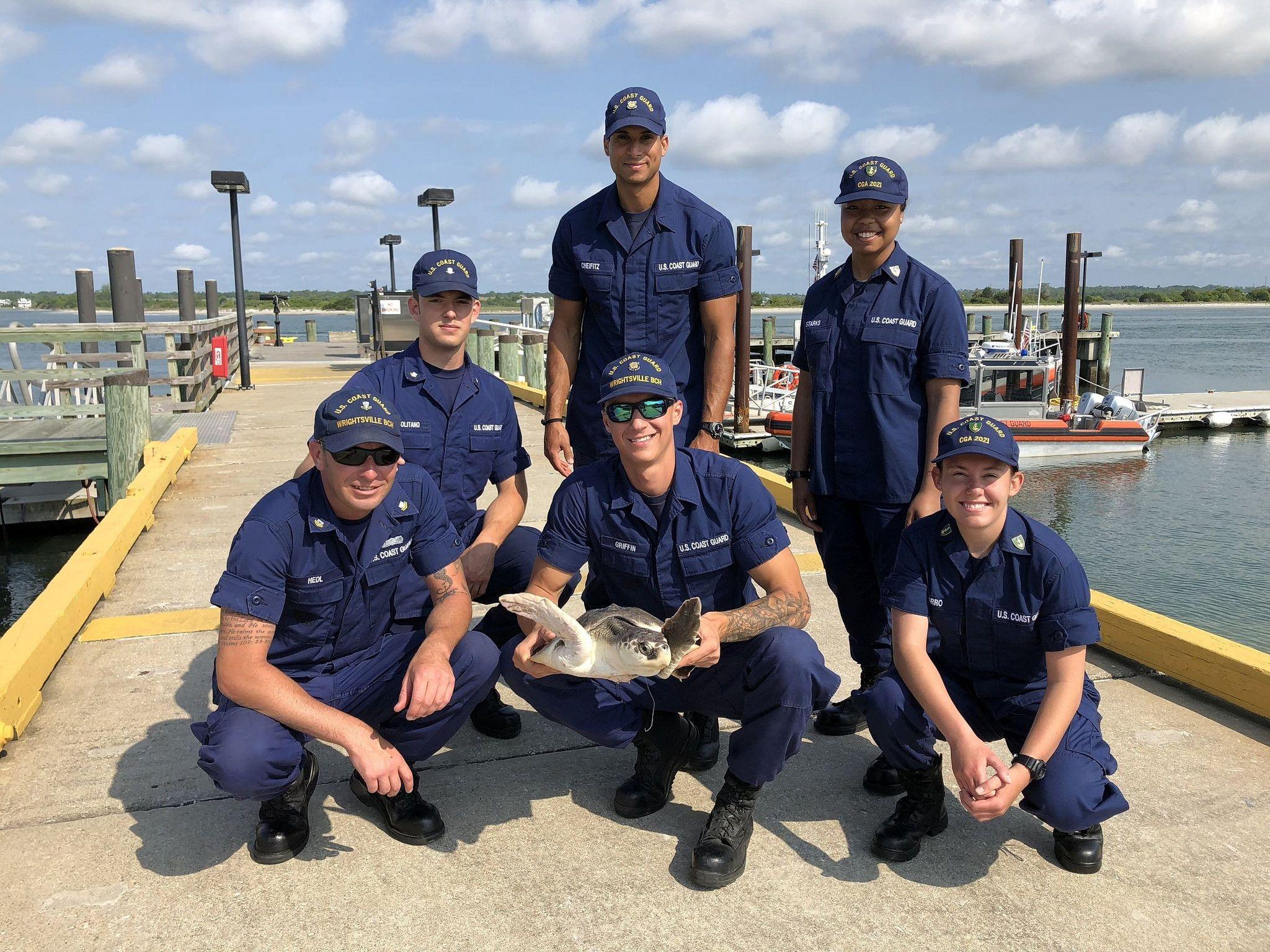 Sea turtle and rescue crew off the coast of North Carolina.